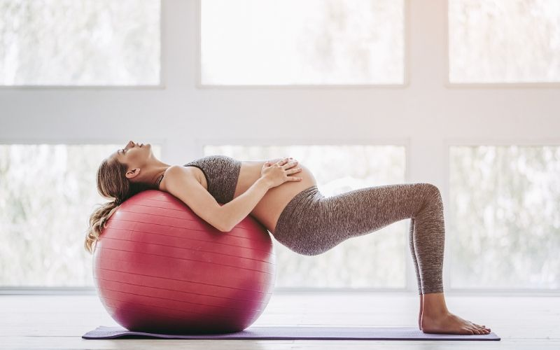 5 Ways To Stretch Your Lower Back With A Medicine Ball